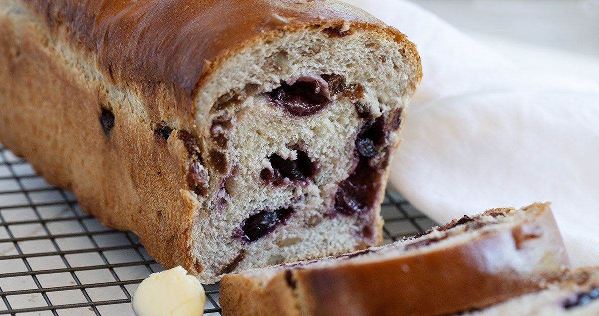 cherry yeast bread on cooling rack with butter
