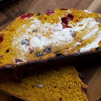 pumpkin cranberry bread slice buttered