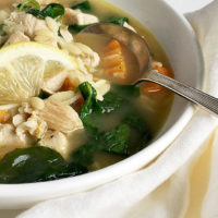 chicken orzo soup in white bowl