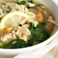 chicken orzo lemon soup in white bowl