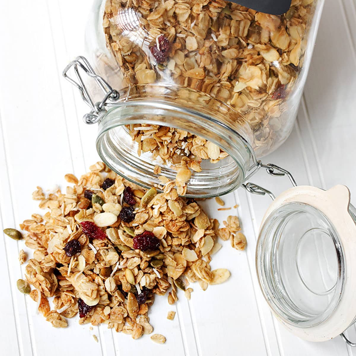 maple granola spilling out of jar