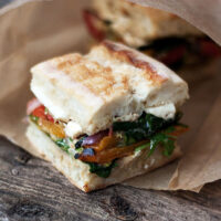 pressed roasted vegetable sandwiches on paper