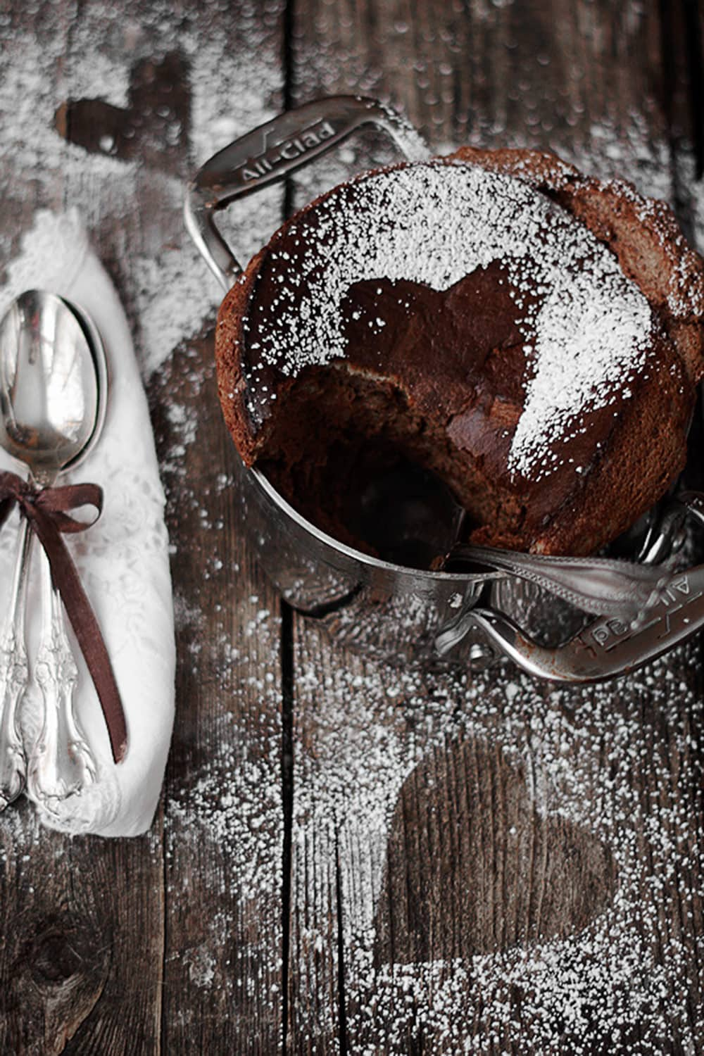 chocolate souffle with some spooned out