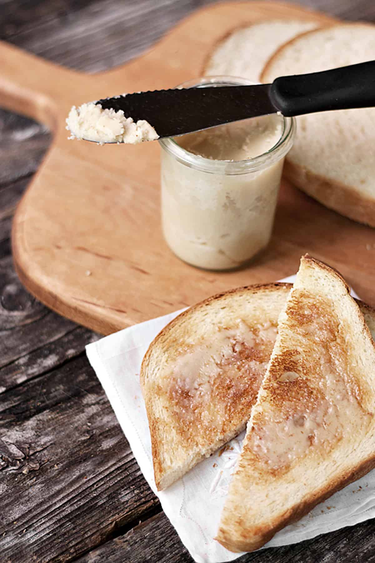 maple butter and bread on cutting board with toast