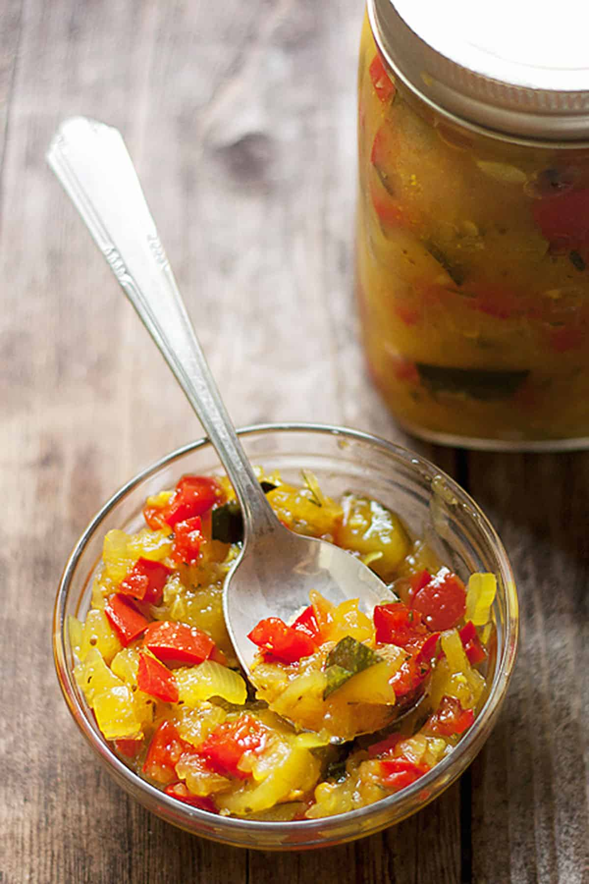 zucchini relish in small bowl with spoon