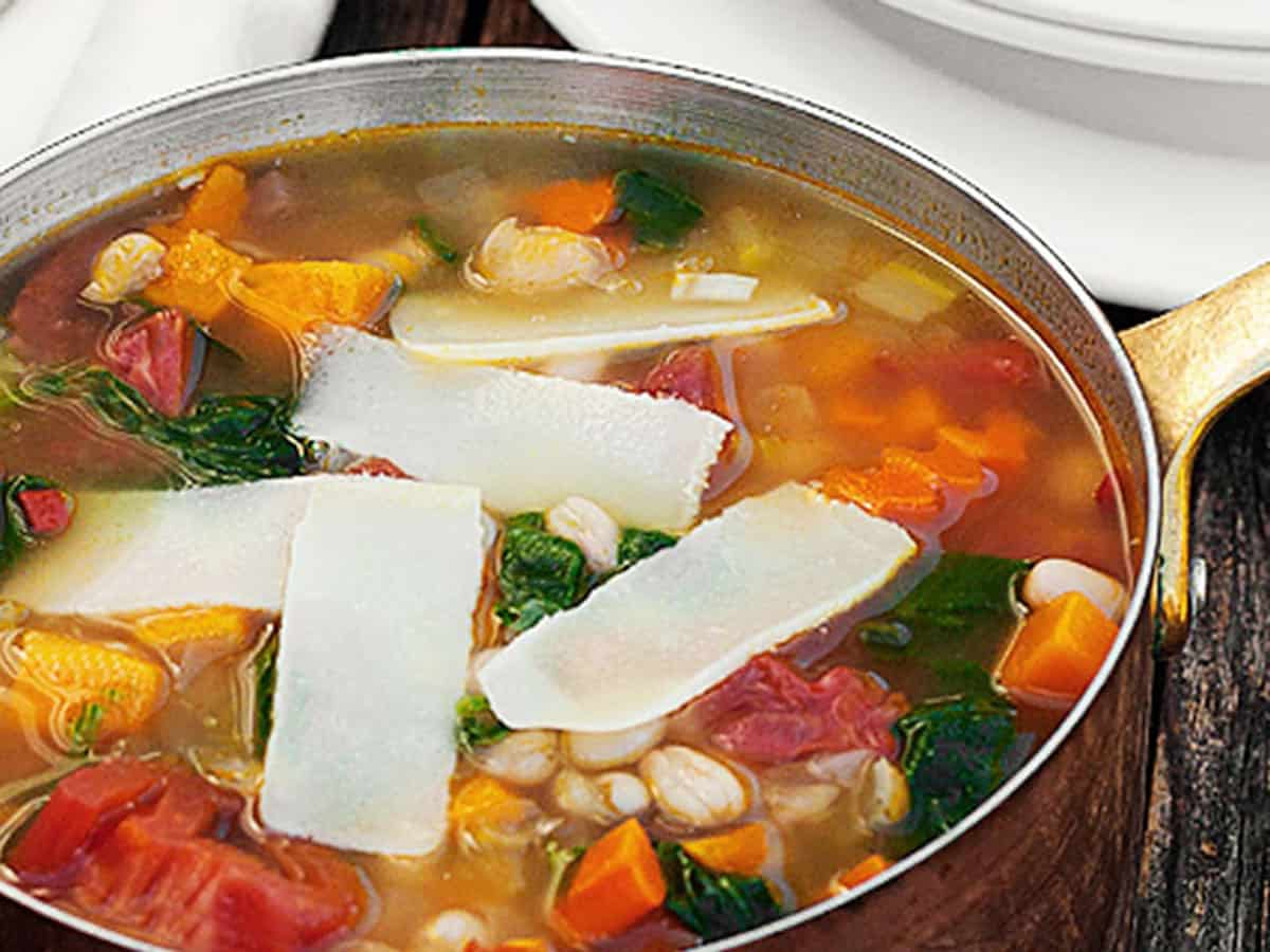 harvest vegetable soup in copper saucepan