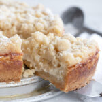 apple cake on plate with a slice out