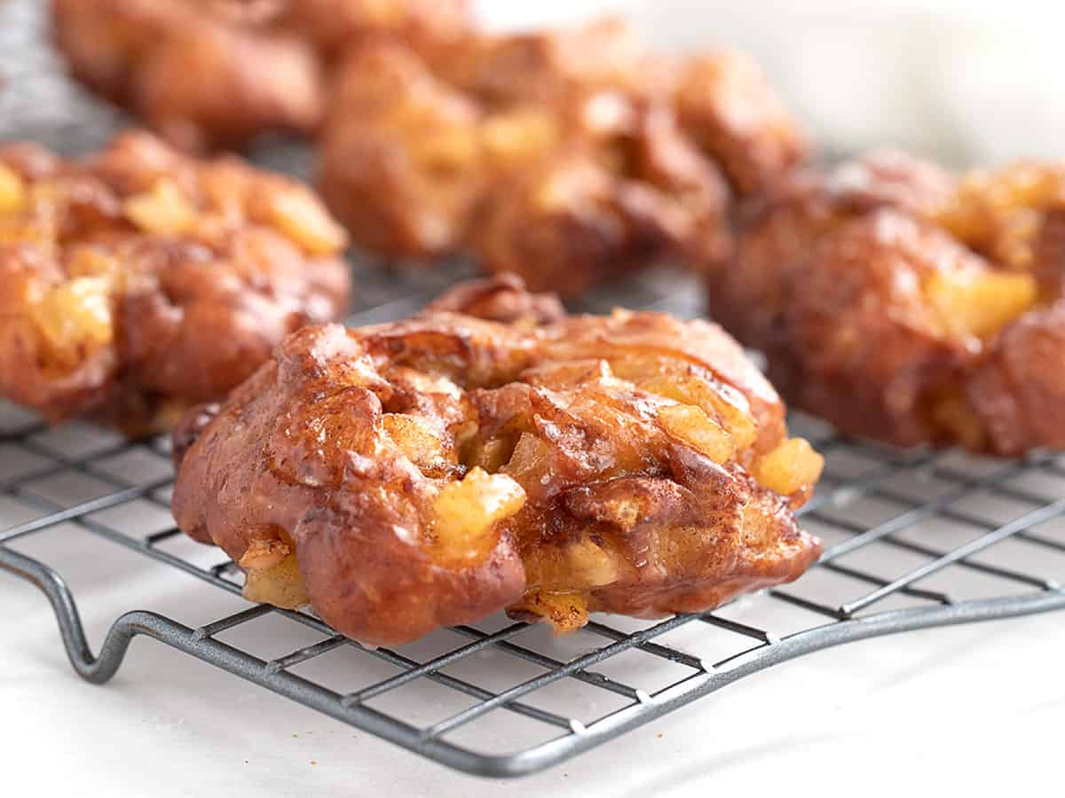 apple fritter yeast doughnuts on cooling rack