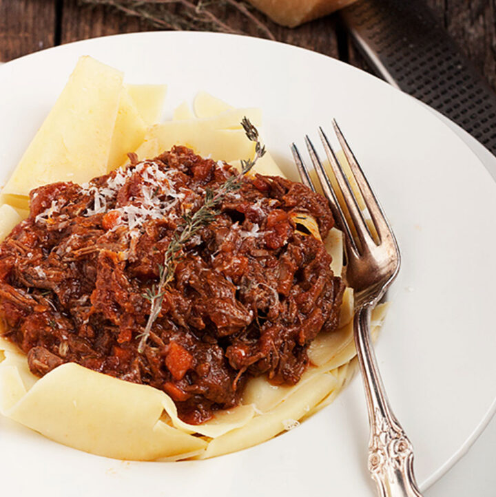 beef ragu pasta sauce on pasta in bowl