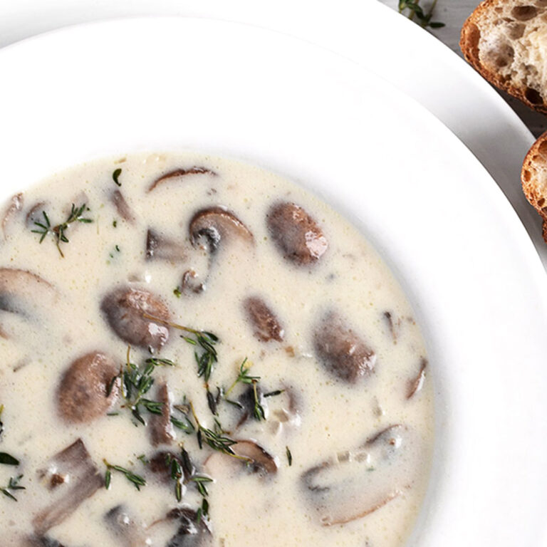 mushroom soup in white bowl with bread