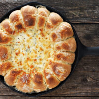 skillet bread and artichoke dip in cast iron skillet