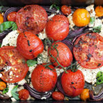 roasted tomatoes and feta in roasting pan