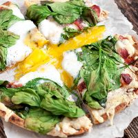Breakfast Pita Bread Pizza - baked whole wheat pita, fontina cheese, bacon, spinach and egg.