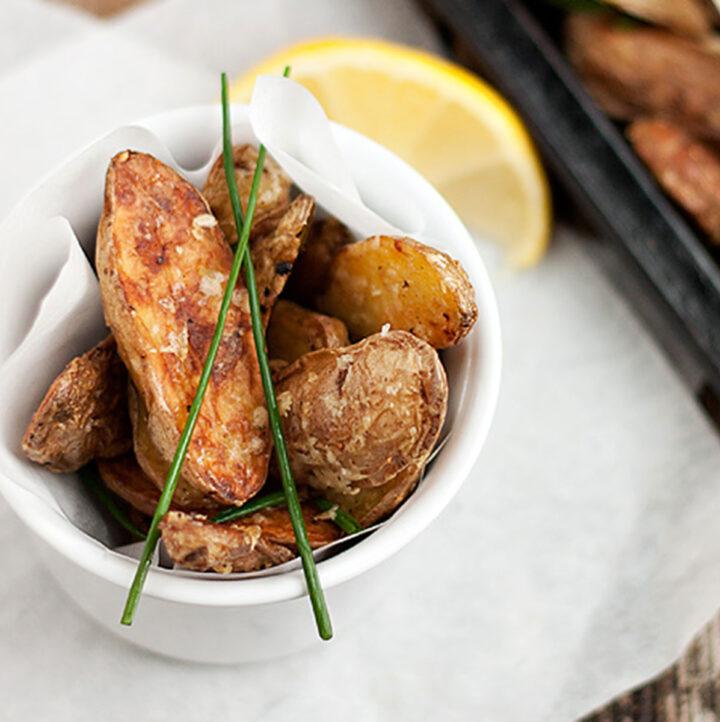 parmesan fingerling potatoes in bowl and on baking sheet