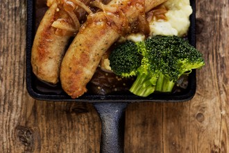 Bangers and Mash: Sausages with Sour Cream Mashed Potatoes and an Onion Mustard Gravy