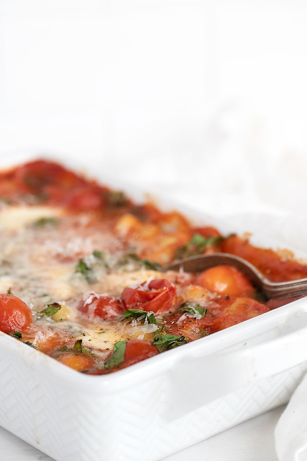 baked gnocchi and tomatoes in baking dish