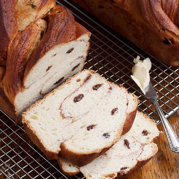 cinnamon raisin twist bread sliced on cooling rack