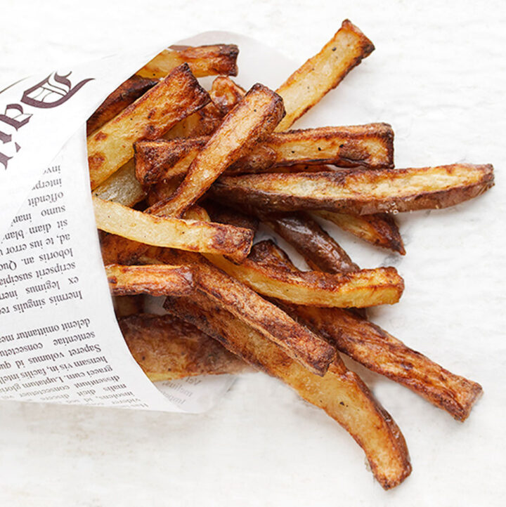 perfect air fryer fries wrapped in newspaper wrap