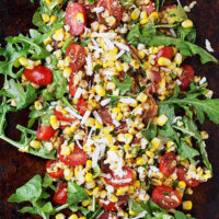 grilled corn salad with tomatoes and arugula