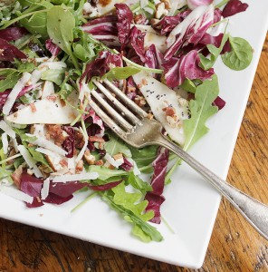 pear salad with radicchio on white plate