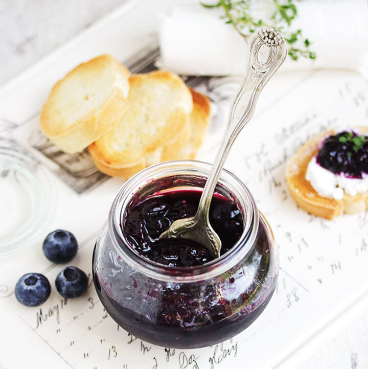 quick pickled blueberries in jar with crostini