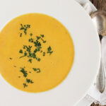 creamy carrot ginger soup in white bowl