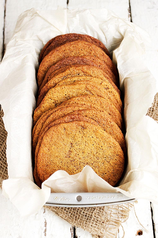 big thin molasses cookies in pan