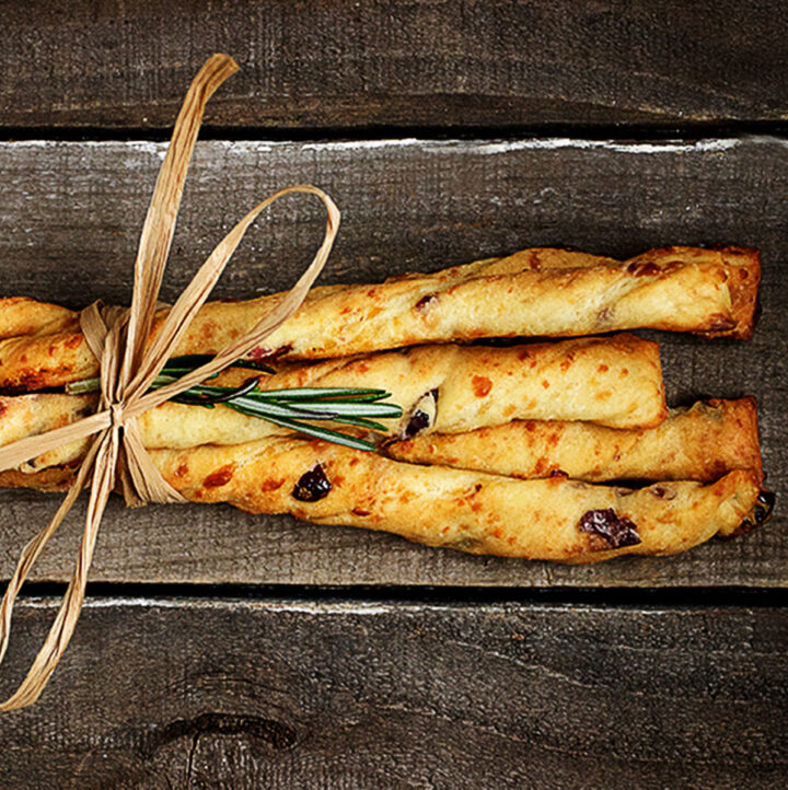 cheese twists with cranberries tied up together