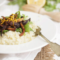 meyer lemon risotto in bowl with pea shoots