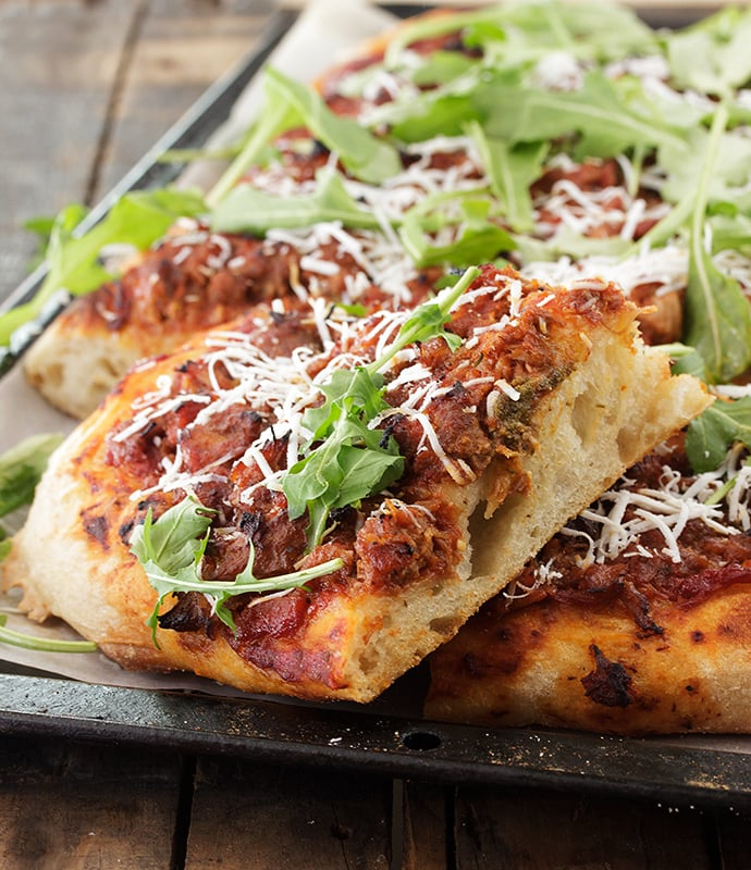 Pork Ragu Pizza with Ricotta Salata and Arugula