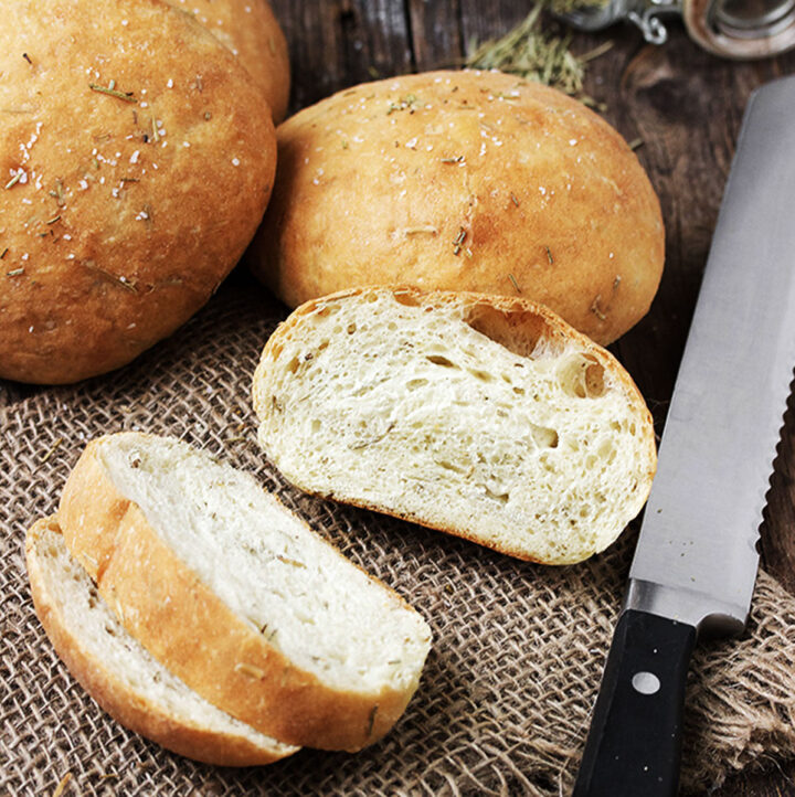 mini rosemary olive oil bread sliced with knife