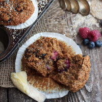 berry bran muffins cut with butter