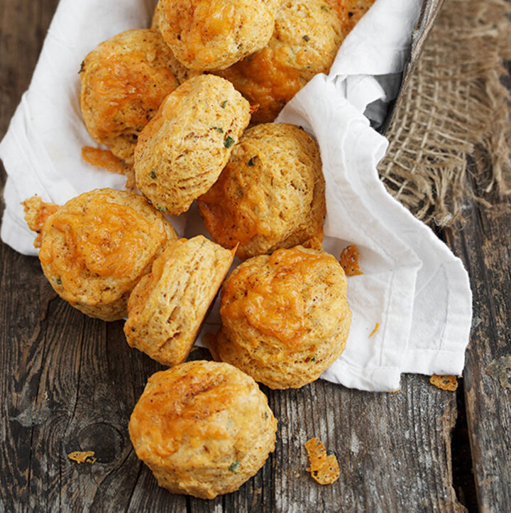 chipotle cheddar biscuits on wood background