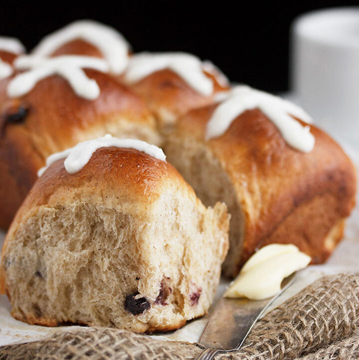 blueberry lemon hot cross buns with knife and butter