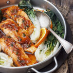 spicy orange salmon with bok choy on platter