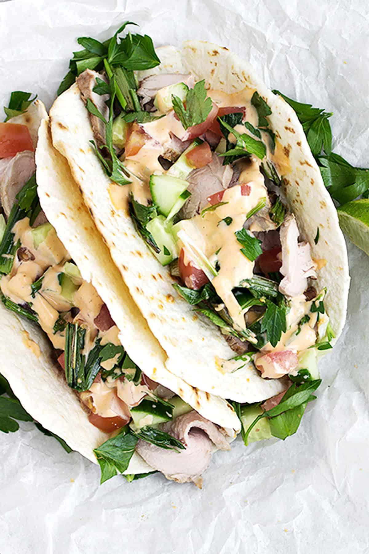 Asian pork tacos on parchment
