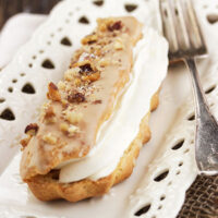 maple eclairs with mascarpone filling on plate with fork