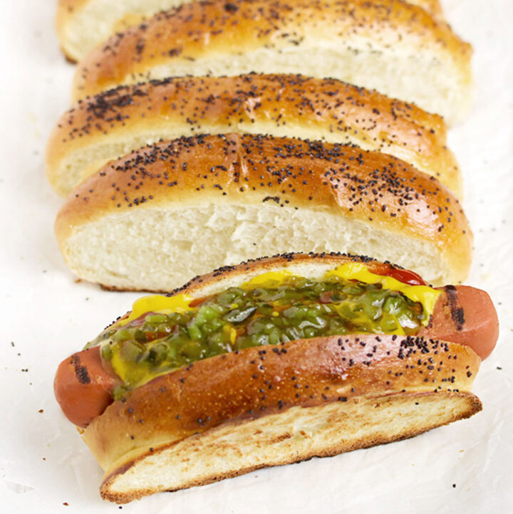 top sliced hot dog buns on white background
