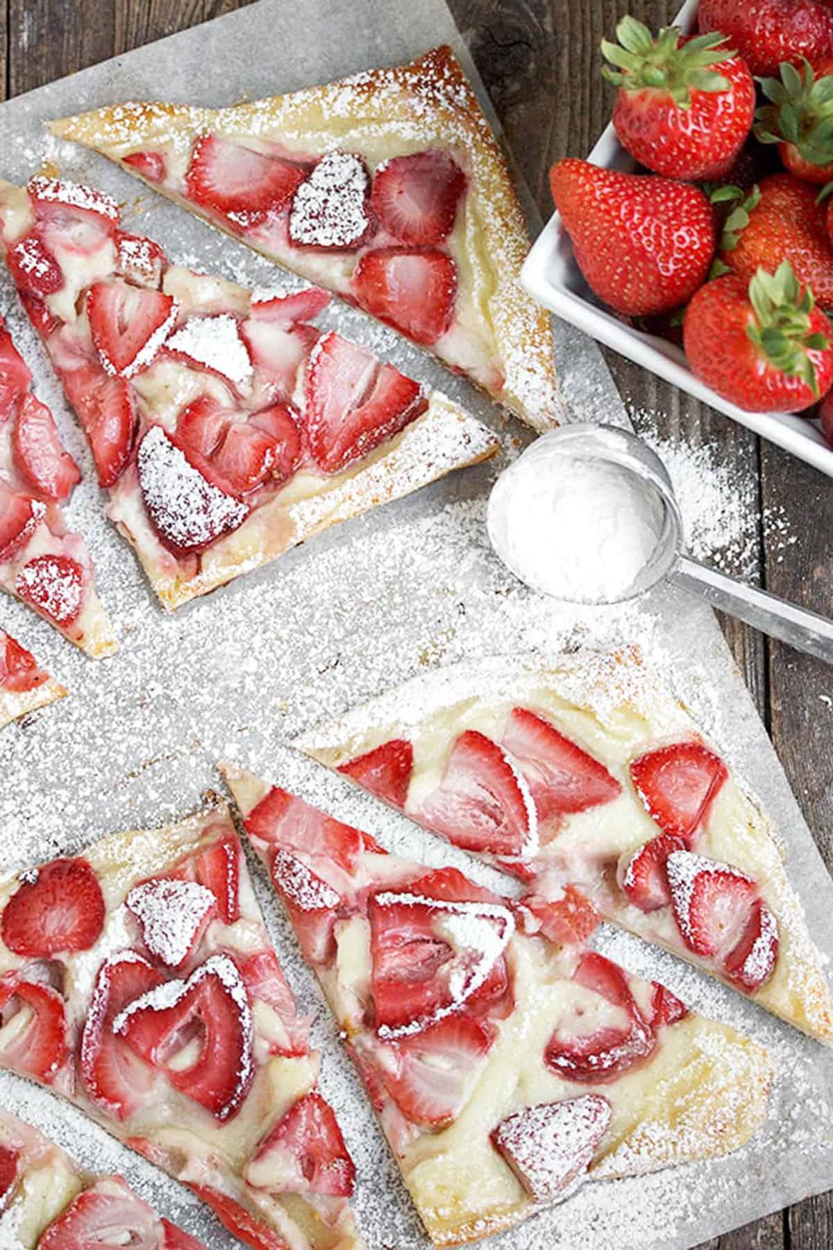 strawberry cream tarts on parchment