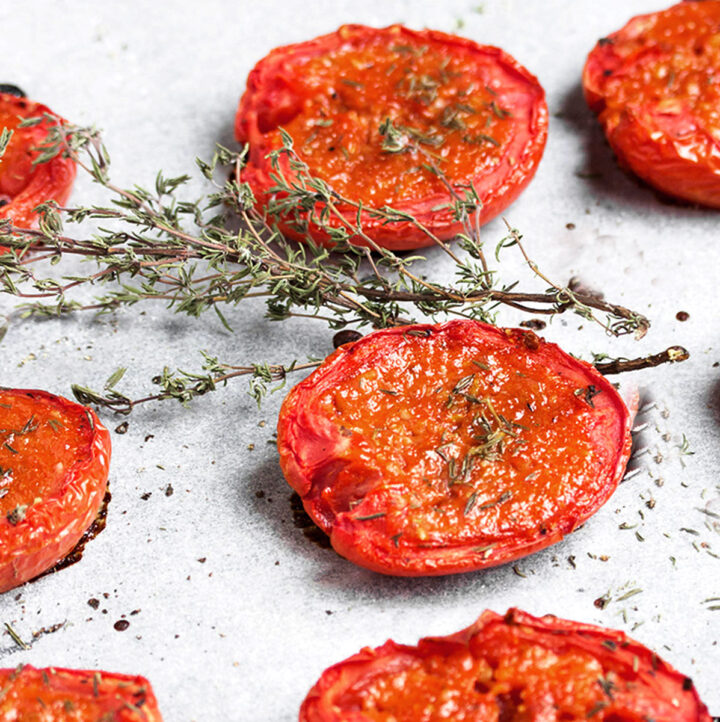 candied roma tomatoes on parchment