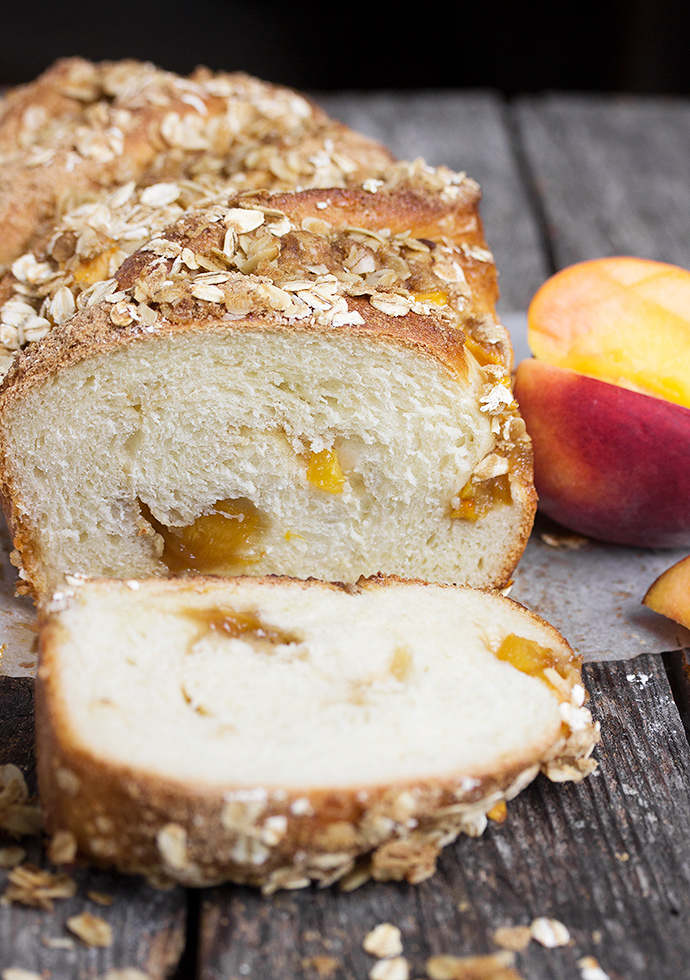 Peach Crisp Bread - inspired by the popular dessert, this yeast bread is studded with fresh peaches and topped with a crunchy oat and brown sugar topping.