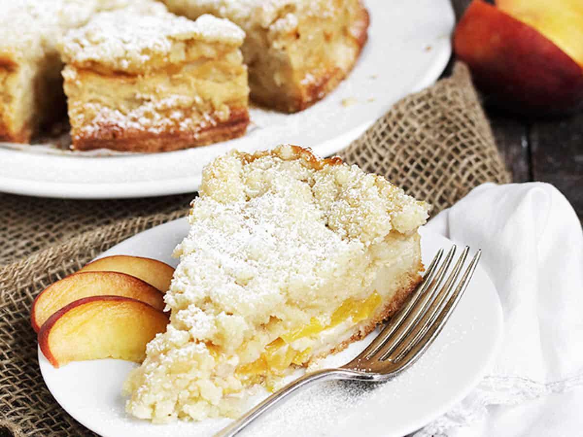 peach crumble cake sliced on plate