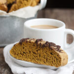 pumpkin spice latte biscotti on plate with coffee