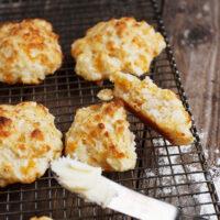 apple cheddar drop biscuits on cooling rack
