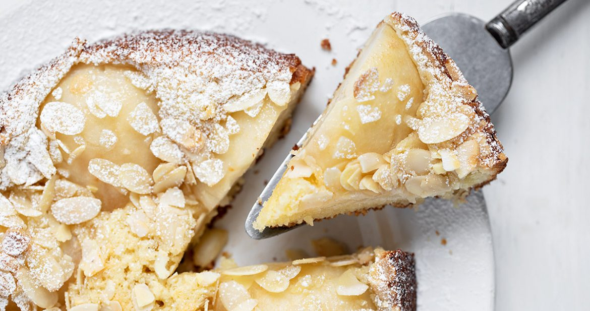 overhead shot of Italian pear almond cake, with a slice cut out