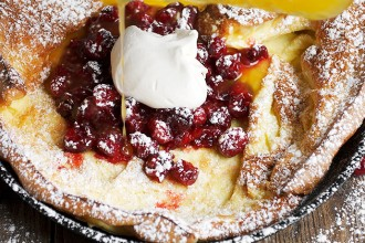 Dutch Baby with Caramelized Cranberries and Clementine Syrup