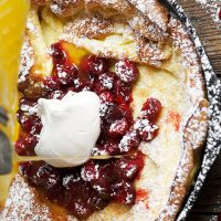 cranberry dutch baby with orange syrup