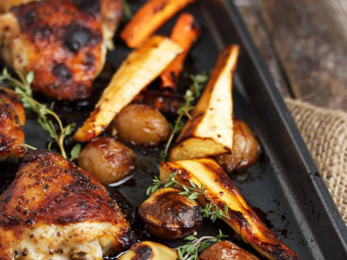 honey mustard sheet pan chicken thighs with vegetables and potatoes
