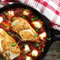 chicken breasts with tomato sauce and bocconcini in skillet