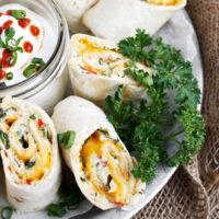antojitos on platter with sour cream dip